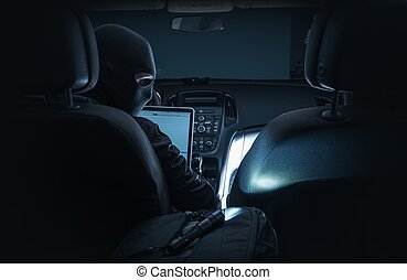 Hacking Car System. Car Hacker in Black Mask Hacking Vehicle...