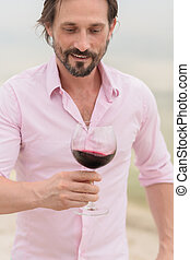Sommelier - Confident and happy sommelier Bearded mature man...