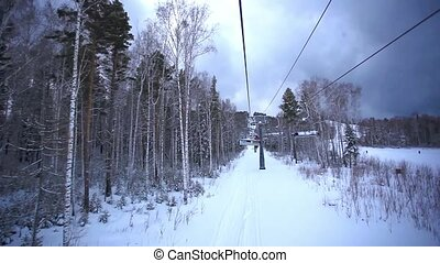 Ski track with chair lift, resort in mountains, Siberia...