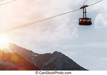 Mountains Gondola Lift at Sunset European Alps Gondola Cable...