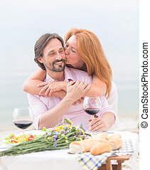Mature couple - Cheerful mature couple embracing by the...