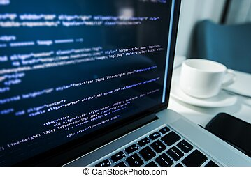 Website Coding. Website HTML Code on the Laptop Display...