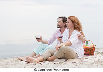 Middle-aged couple in picnic - Happy middle-aged couple...