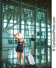 airport and beautiful passenger with luggage
