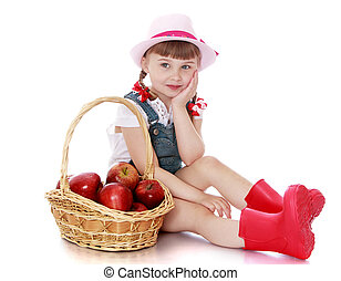 Girl with basket of apples - The little blonde girl in denim...