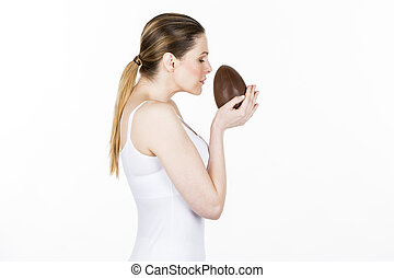 woman holding chocolate easter egg