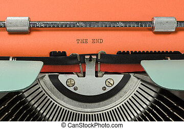 Vintage Typewriter With Phrase THE END Typed in Orange Paper...