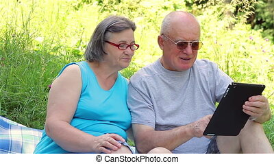 Senior couple with tablet pc