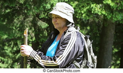Senior tourist woman in forest - Senior tourist woman...