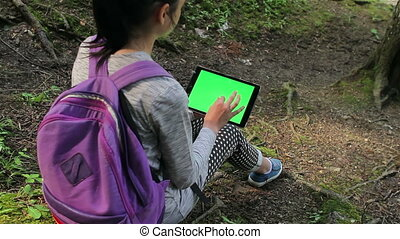 Teenage girl using tablet pc - Teenage girl searching on...
