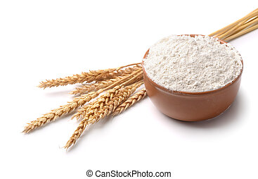 Wheat flour and wheat ears isolated on white