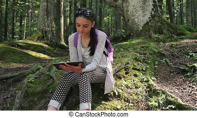 Tourist girl using a tablet pc