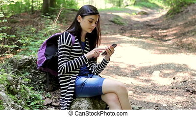 Girl tourist using smartphone - Teenager girl tourist using...