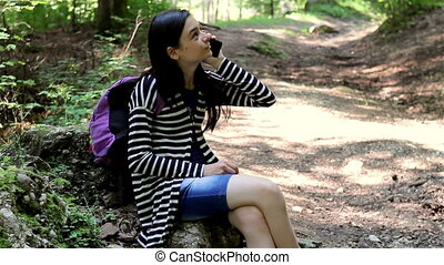 Young girl talking on smartphone - Tourist young girl...
