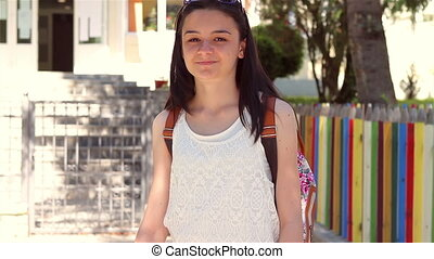Young girl going back to school - Happy student girl with...