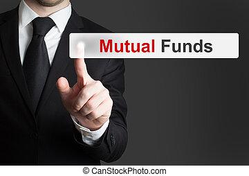 businessman pushing touchscreen button mutual funds -...