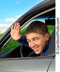 Teenager in the Car - Cheerful Teenager sit in the Car and...