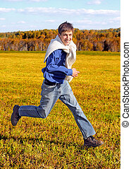 Happy Teenager in the Field - Joyful Teenager run in the...