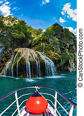 Waterfall in the river Verdon - Pleasure boat with the red...