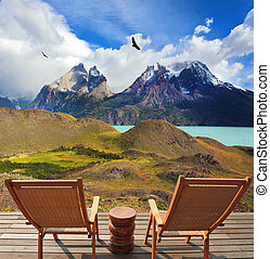 Wooden chairs in the park Torres del Paine On the horizon is...