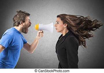 Shouting to a woman - Man shouting with megaphone to a...