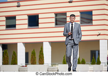 senior businessman outdoors - urban outdoor portrait of...