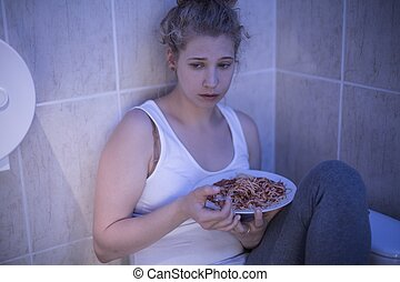 Overeating sad girl - Picture of overeating sad girl sitting...