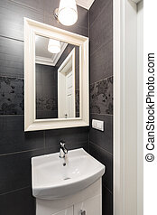 Washbasin and mirror - Photo of washbasin and mirror with...