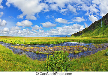 The streams of meltwater - Warm summer days in Iceland Green...