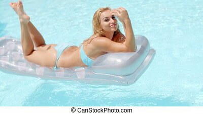 Seductive Woman on a Floating Mattress in the Pool - Pretty...