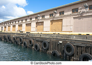 Boat dock in marina - An empty supply dock in a harbor...