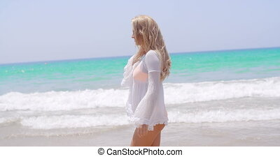 Blond Girl Walking in White Tunic on the Beach - Blond Girl...