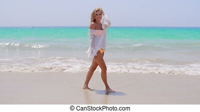 Pretty Young Woman Standing Against Ocean - Full Length Shot...