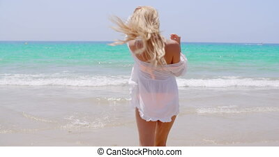 Rear View of Young Blond Girl on the Beach - Rear View of...