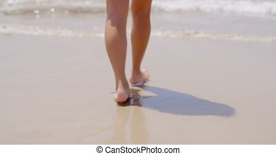 Close up Woman Feet Walking at the Beach