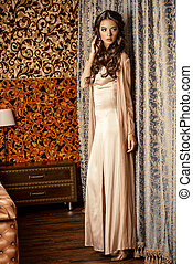 classy woman - Charming woman in light evening dress in the...