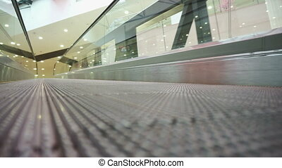 Low angle view looking to top of modern escalator - Low...