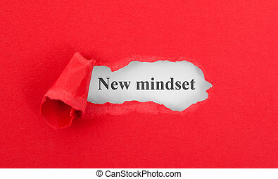 Text appearing behind torn red envelop - New mindset