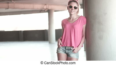 Woman In Car Park - Attractive young woman wearing...