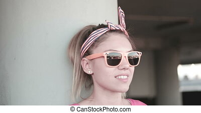 Young Woman In Sunglasses - Attractive young woman wearing...