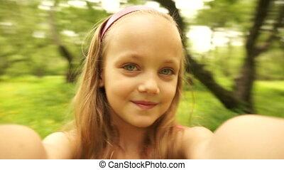 Wonderful girl spinning in the park. - Wonderful girl seven...