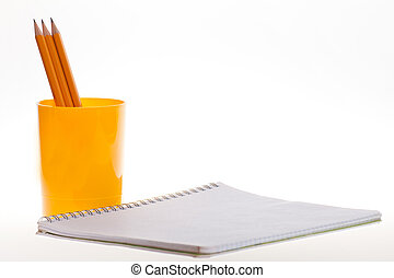 notebook and pencils on a white background - cup with...