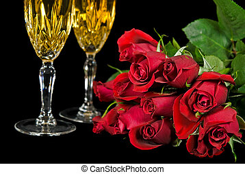 Dozen Roses - Dozen red roses with champagne flutes on black...
