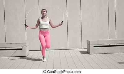 Young Woman Exercising Outdoors - Attractive young woman in...