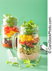 vegan quinoa vegetable salad in mason jars