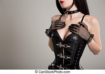 Close-up shot of sexy woman in black fetish corset