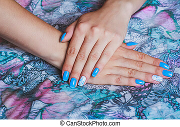 Light blue nail art on butterfly print clothes