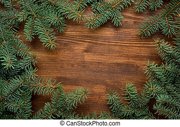 fir tree on wooden board background with copy space.