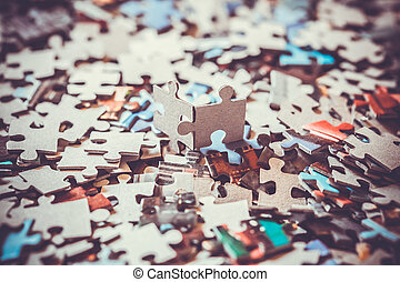 pieces of a puzzle - close up of the pieces of a puzzle