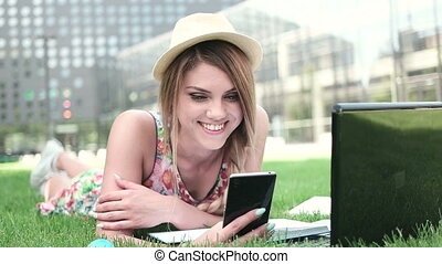 Young Woman Using Phone And Laptop - Attractive young woman...